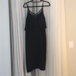 Super sleek and sexy black midi dress